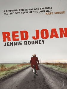 Joan inconspicuous on a bike - except perhaps for the bit of a giveaway Red Coat!