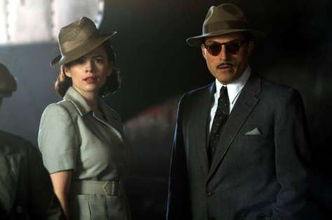 Now that's what I call wearing a hat at a jaunty angle! It could only happen in a spy film! (Hayley Atwell and Rufus Sewell in BBC Film of Restless)